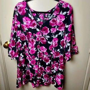 Torrid floral 3/4 sleeve top. Back zip size 2
